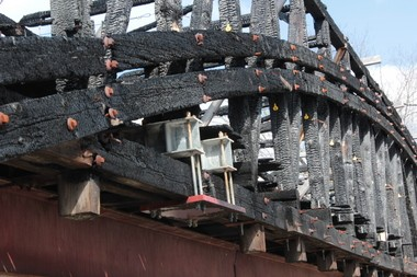 Charred timbers on the Dellville Bridge. The timbers represent the oldest part of the structure, and might be able to be saved. The fire, which took place in 2014, remains under investigation.