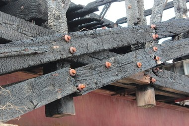 A close-up view of the charred timbers on the Dellville Bridge. Work to rebuild the bridge could begin this summer.