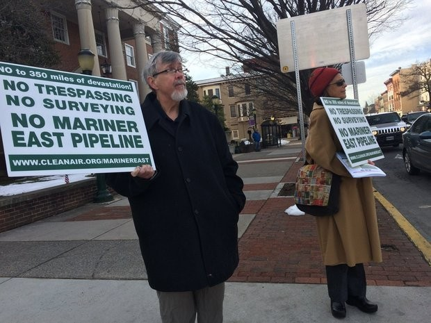 Nathan Sooy and Betsy Conover hold signs outside of the Cumberland County Courthouse in support of several Upper Frankford Township residents who are fighting eminent domain proceedings initiated by a pipeline company.