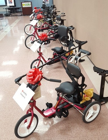 Several of the adaptive bikes from Variety - the Children's Charity are lined up prior to Monday's presentation.