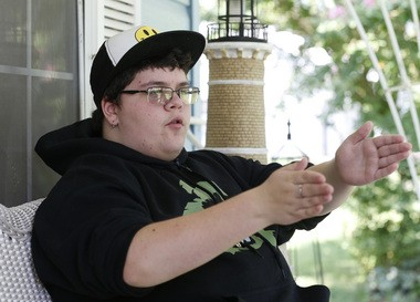 Gavin Grimm, shown here at his home in Gloucester, Va., is a transgender student whose demand to use the boys' restrooms has divided the community and prompted a lawsuit. (AP Photo/Steve Helber)