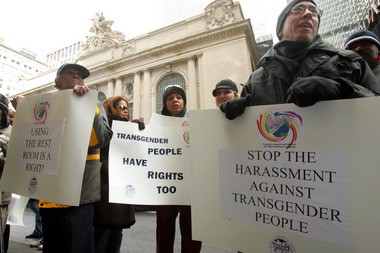 Supporters of Helena Stone, not in photo, a 70 year old transgender woman whose legal name is Henry McGuinness, stand outside Grand Central Terminal during a demonstration against the Metropolitan Transportation Authority police, Tuesday, Feb. 28, 2006, in New York. Stone was arrested on disorderly conduct charges on Sept. 29, 2005, on Dec. 17, 2005 and on Jan. 12, 2006, for using the women's bathroom at Grand Central Terminal. (AP Photo/Mary Altaffer)