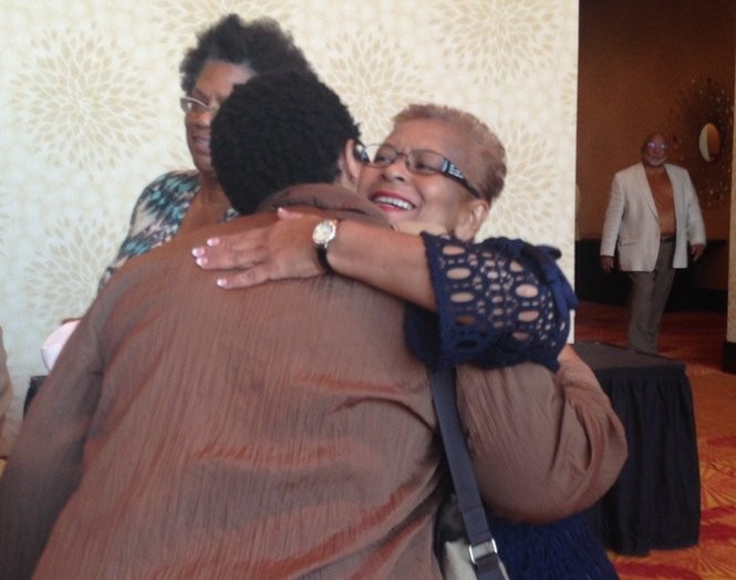 NAACP PA members embrace Saturday during a quarterly meeting at the Marriott Penn Square in Lancaster.