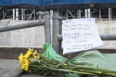 Flowers and a note sit outside the former site of the Joe Paterno statue outside Beaver Stadium at Penn State University in State College. PAUL CHAPLIN, The Patriot-News