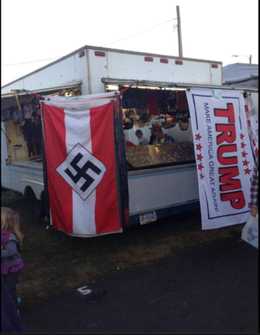 A screen shot of the photo that has circulated across social media of Nazi flag on display next to a Trump flag at the Bloomsburg Fair.
