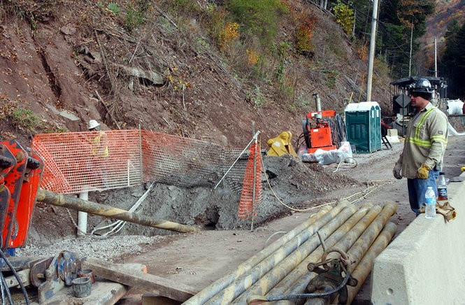 A worker watches the horizontal drilling operation along Wallis Run Road in northern Lycoming County. Sunoco Logistics hopes to avoid future damage from flooding by burying replacement of a section of broken pipeline at least 35 feet under the stream.