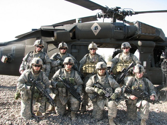 Infantry buddies in Iraq in 2008. Front row, from left, unidentified, Aaron Burns, Gannon, Sowell. Back row, Shane Duffy (KIA 06/04/2008), Bradley Link, Cody Legg (KIA 06/04/2008) and Rob Easley. The fierce firefight that would claim three of Sgt. Rob Easley's Infantry buddies in Iraq in June, 2008, spurred a major military career change in which Easley would train as an Explosive Ordinance Disposal specialist -- a position he believed would give him more control over the danger. This theory would be put to the test during Easley's next deployment in Afghanistan beginning in January, 2012. Photo provided by Rob Easley