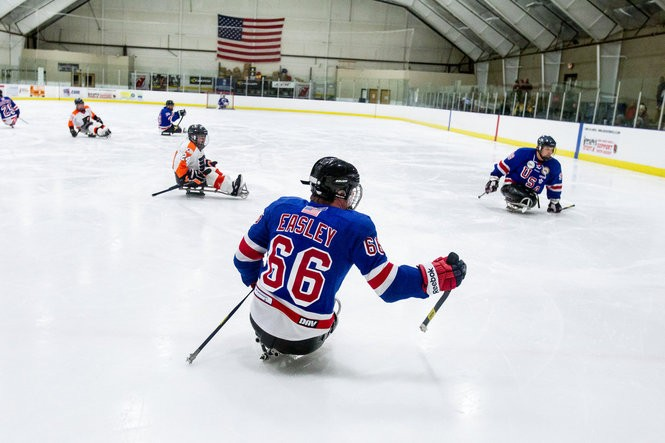Rob Easley plays with his USA sled hockey team in a tournament in Flemington, NJ on December 21, 2014.
