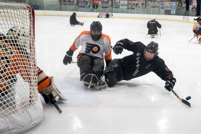 Rob Easley plays sled hockey with his team the Warriors during a tournament at Twin Ponds East.