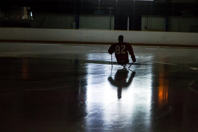 Rob Easley skates around the rink following a sled hockey practice in Bethesda, Md. on June 13, 2013. Amid his long recovery, sled hockey becomes Rob's preferred method of both physical and mental therapy, despite the risks to his still-healing left limb.