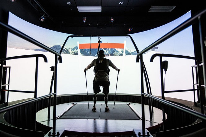 Rob Easley undergoes an advanced form of physical therapy that can safely immerse him in almost any situation using an IMAX-like movie screen and a movable treadmill platform at Walter Reed National Military Medical Center, Bethesda, Md. Here, he simulates downhill skiing.