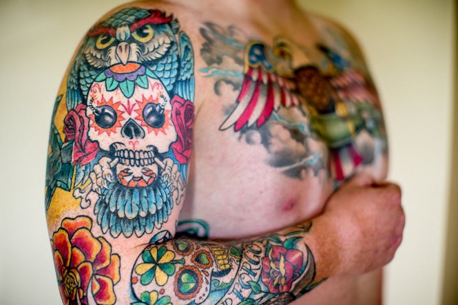 The fierce firefight that would claim three of Sgt. Rob Easley's Infantry buddies in Iraq in June, 2008, is memorialized in Rob's increasingly elaborate tattoos. Three skulls, along with individual details unique to each deceased buddy, dominate the designs of the separate tattoos dedicated to the memory of his fallen-soldier friends. Since then, Rob's tattoos have expanded into other themes and designs, with the body art covering more and more space on his arms and torso.