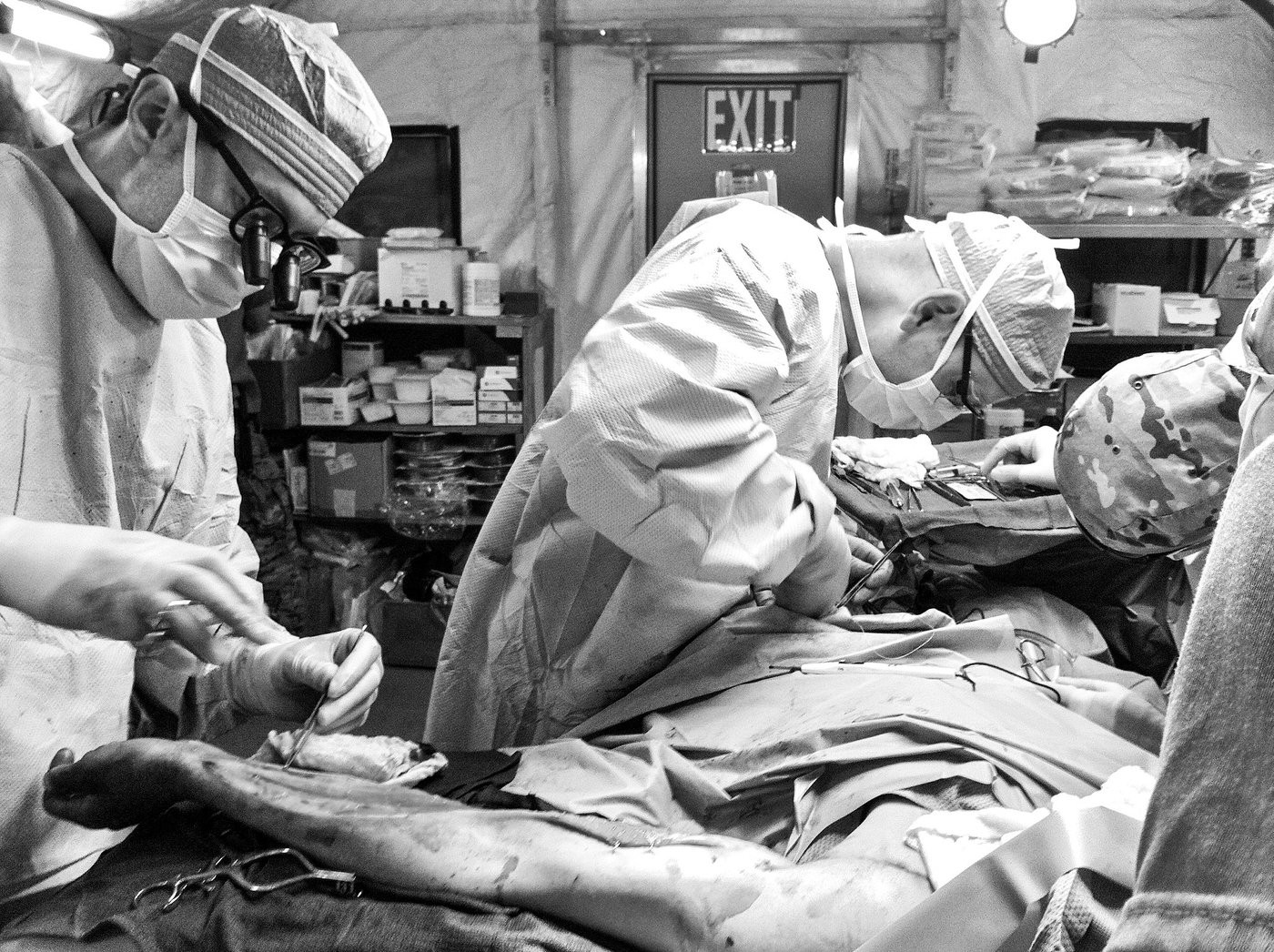 Lt. Col. (Dr.) Jean-Claude G. D'Alleyrand, center, performs trauma surgery on a soldier wounded in Afghanistan in 2012. The following year, Dr. D'Alleyrand was named Chief of Orthopedic Trauma Surgery at Walter Reed National Military Medical Center in Bethesda, Maryland. There, he develops a program for lengthening the limbs of combat-wounded amputees with extremely short residual limbs who would otherwise be unable to use prosthetics. He takes over Sgt. Rob Easley's case in 2014, as Rob is a perfect candidate for the treatment that could allow him to walk again.