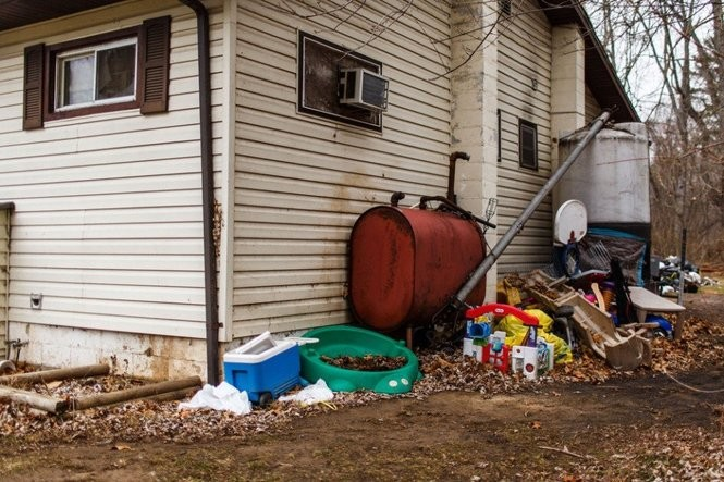 The Weyant home as it appeared Monday, with a pile of children's toys and other debris in the yard.