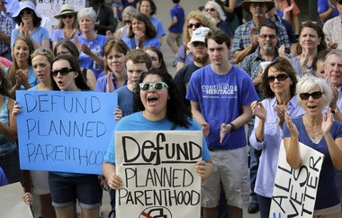 Planned Parenthood, long the target of conservatives, this week released findings of focus groups that find supporters of President-elect Donald Trump at odds with Republican plans to defund the organization. This file photo shows anti-abortion activists rallying in Texas, to condemn the use in medical research of tissue samples obtained from aborted fetuses.