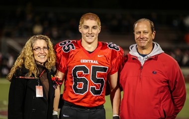 Timothy Piazza (center) is pictured with his parents, Evelyn and James.