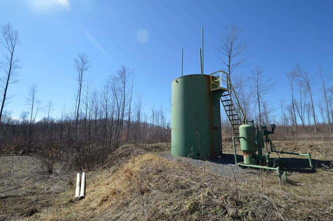 The site of a proposed frack water disposal well in Highland Township, Pa., is pictured. The plan calls for an existing well at the site to be converted into a disposal well. Photo by Colin Deppen.