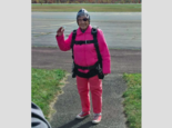 Eila Campbell, of Williamsport waves as she celebrates her 94th birthday by going skydiving with her granddaughter and great-granddaughter at Above the Poconos Skydivers at Hazleton Regional Airport in Hazleton.