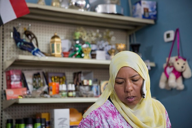 Ola Soweilam talks on the phone at her store, El Ola Mediterranean in Camp Hill, on July 18, 2016. Her family has expressed shock that her ex-husband targeted police in a shooting spree Friday night.