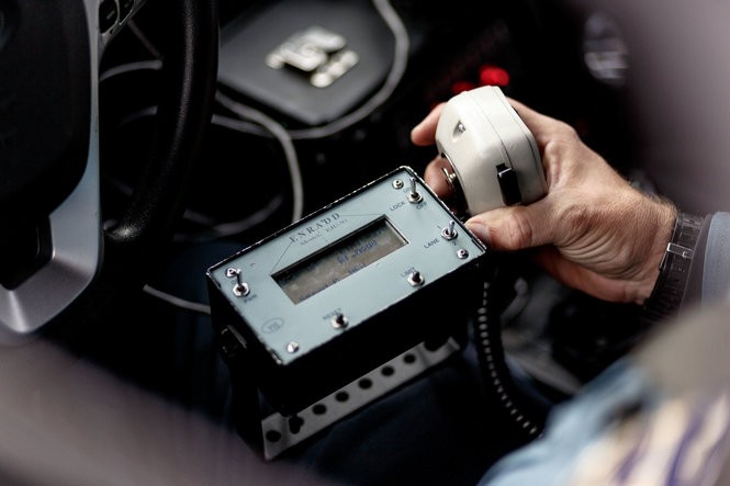 A police officer, monitoring an ENRADD device remotely from his or her patrol car, can pull over a driver if the device determines they're speeding (James Robinson for PennLive.com)