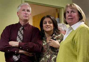 Sara Ganim, center, with Patriot-News/PennLive editors Mike Feeley and Cate Barron as the newspaper wins the 2012 Pulitzer Prize for local reporting on the Jerry Sandusky scandal.