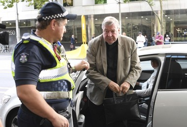 Vatican Cardinal George Pell arrives at the Melbourne Magistrates Court in Melbourne, Australia, in March. A father has testified in an Australian court that his son said he was sexually abused by Pell during a waterskiing outing years ago. A defense lawyer accused the man's son of lying. (Joe Castro/AAP via AP)