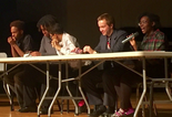 Artur Samarin, alias Asher Potts, at a 2016 youth town hall. He sat second from the right.