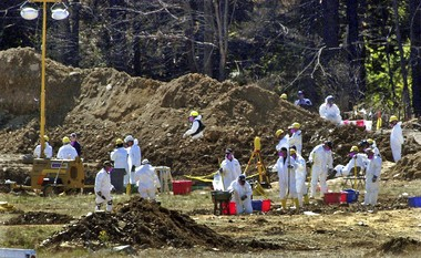 FILE - In this Sept. 16, 2001 file photo, FBI personnel continue excavating the site where United Flight 93 crashed after the jet was hijacked during the 9/11 terrorist attacks, near Shanksville, Pa.