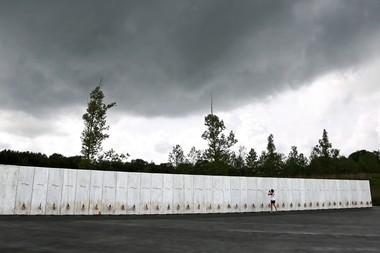 FILE - In this May 31, 2018 file photo, a visitor to the Flight 93 National Memorial pauses at the Wall of Names honoring 40 passengers and crew members of United Flight 93 killed when the hijacked jet crashed at the site during the 9/11 terrorist attacks, near Shanksville, Pa.
