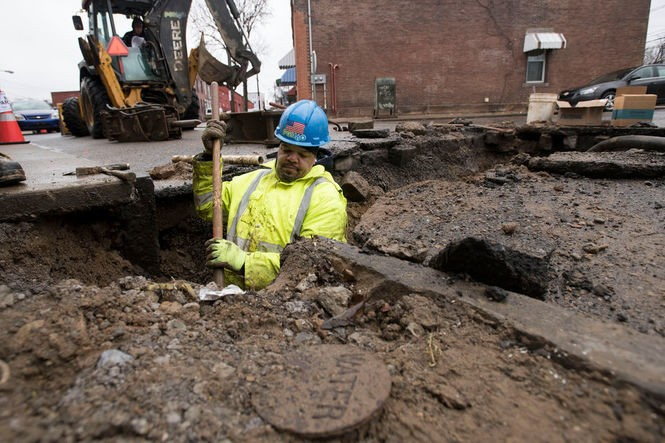 Pittsburgh Water and Sewer Authority General laborer Sager McDill replaces a lead service line on Denny Street on Thursday Feb. 22, 2018 in Lawrenceville.