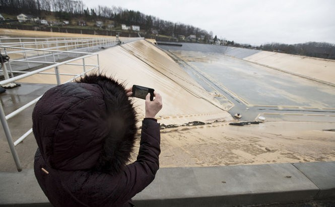 Rebecca Zito,Communications Project Manager at Pittsburgh Water and Sewer Authority, takes a photo of the Lanpher Reservoir on Thursday Feb. 22, 2018 in Shaler.