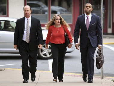 Jim and Evelyn Piazza walk toward the Courthouse Annex for former Beta Theta Pi fraternity member Ryan Burke's sentencing Tuesday, July 31, 2018 in Bellefonte, Pa.