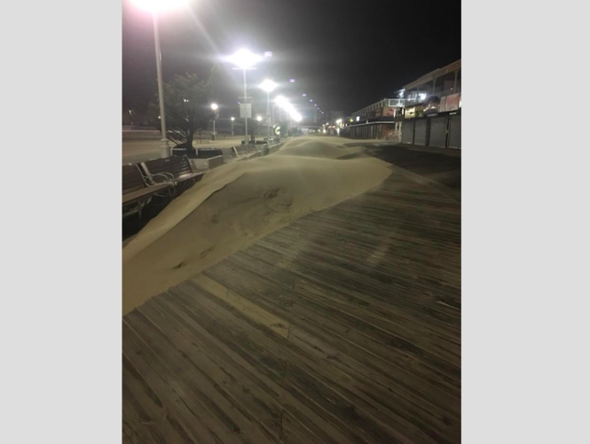 Rough surf has pushed sand dunes on the boardwalk in Ocean City, Maryland. Areas along the coast are currently bracing for the impact of the Category 4 Hurricane Florence.