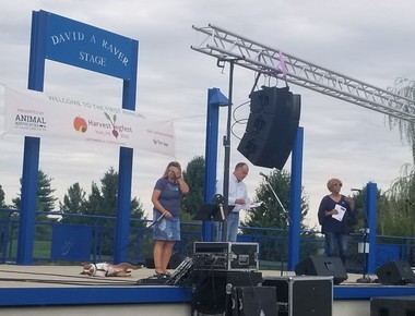 Libre, Rep. Carol Hill-Evans, and Rep. Keith Gillespie gather on stage Saturday at the Harvest Vegfest 2018.