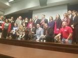 Animal advocates and lawmakers gather Monday for a press conference inside the Capitol.