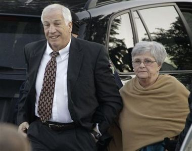 In this Dec. 13, 2011 file photo, former Penn State assistant football coach Jerry Sandusky arrives with his wife, Dottie Sandusky, for a preliminary hearing at the Centre County Courthouse in Bellefonte, Pa.