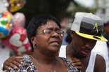 Alisa Evans, mother of shooting victim Jeremy Evans, is comforted by her son, Jordan Tonsel, while speaking with the media during a vigil in honor of Jeremy at Sixth and Seneca streets in Harrisburg in July 2011.