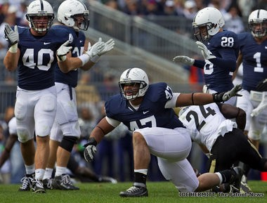 Penn State defensive lineman Jordan Hill celebrates after making a 3rd down stop during the 1st quarter at Beaver Stadium.