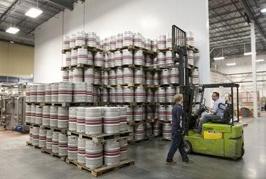 John Trogner moves kegs at the Troegs brewery in Hershey in October 2011. JOHN C. WHITEHEAD/The Patriot-News