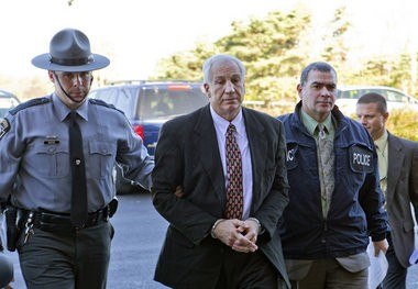 Former Penn State football assistant coach Jerry Sandusky, center, when he was arrested for numerous child sex crimes in November 2011. In June 2012, Sandusky was convicted on 45 of 48 counts.