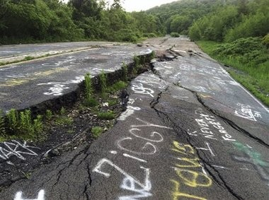 In this May 24, 2012 photo, Route 61 is shown eroded and covered in graffiti in Centralia, Pa. (AP Photo/Michael Rubinkam)