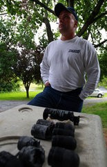 Gerald Thompson, stands next to some of the spent ordinance left behind by the state police after a raid at his home in South Hanover Twp. Friday June 1, 2012. CHRIS KNIGHT, The Patriot-News