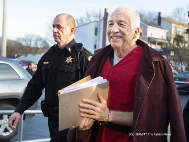 Jerry Sandusky is escorted into Centre County Courthouse for his appeals hearing before Judge John M. Cleland Jr. Sandusky was convicted last June for sexually abusing 10 boys and received a sentence of 30 to 60 years. JOE HERMITT, The Patriot-News
