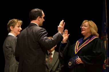 Eugene A. DePasquale is sworn in as Auditor General of Pennsylvania by State Supreme Court Justice Debra Todd as his wife Tracey DePasquale looks on at the State Museum Auditorium.