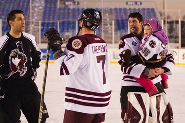 Hershey Bears alumni goalie Frederic Cassivi, right, skates around the rink with his daughter, Ella, after the Bears' game against the Wilkes-Barre/Scranton Penguins alumni in the Capital BlueCross AHL Outdoor Classic alumni game at Hersheypark Stadium. Paul Chaplin | pchaplin@pennlive.com
