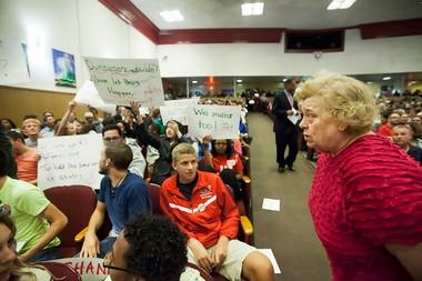Susquehanna Township School Board member Linda Butler, right, tells students to put their signs down at the start of the school board meeting on Monday September 23, 2013. Christine Baker | cbaker@pennlive.com