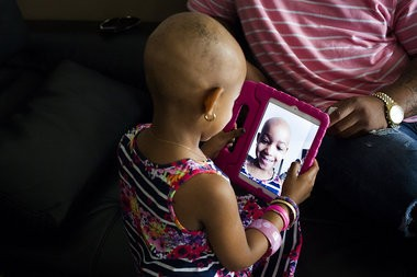 Four-year-old Leah Still takes a selfie while sitting in the living room of her mother Channing Smythe's home in Wilmington, Del. on July 13, 2014. Elizabeth Frantz, PennLive