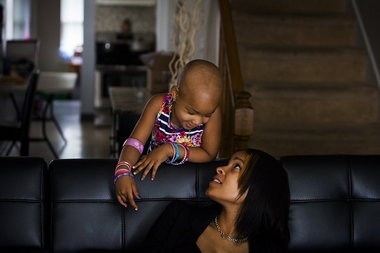Four-year-old Leah Still talks to her mother Channing Smythe while leaning over the couch in Smythe's home in Wilmington, Del. on July 13, 2014.
