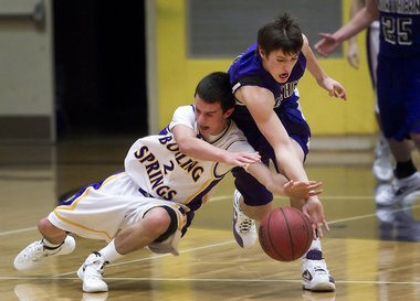 Jackie Lithgow, left, playing for Boiling Springs, battles Northern's Evan Werner for a loose ball during a game on Dec. 23, 2011.