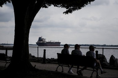 Ships can be seen on the Delaware River from Market Square Memorial Park. The borough of Marcus Hook in Delaware County is straddled by the Monroe Energy Trainer Refinery and the Sunoco Logistics Marcus Hook Industrial Complex, July 30, 2015. Dan Gleiter | dgleiter@pennlive.com